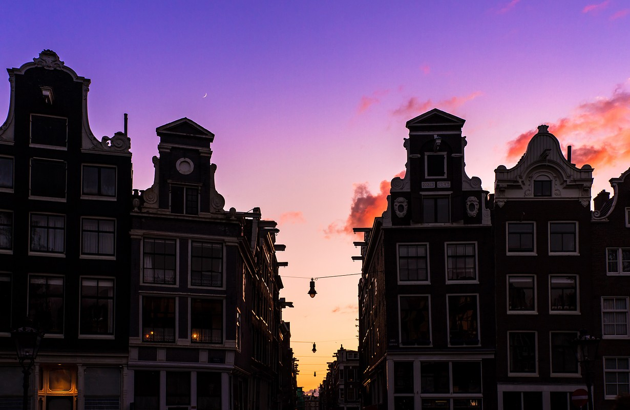 Beautiful silhouettes of canal houses at the little nine streets in Amsterdam, the Netherlands, at sunset