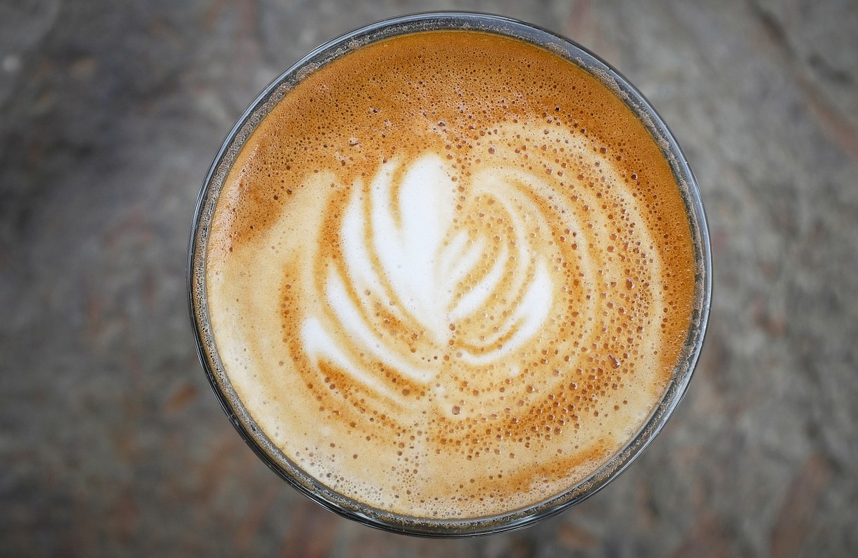 Fresh latte coffee cup art swirl
