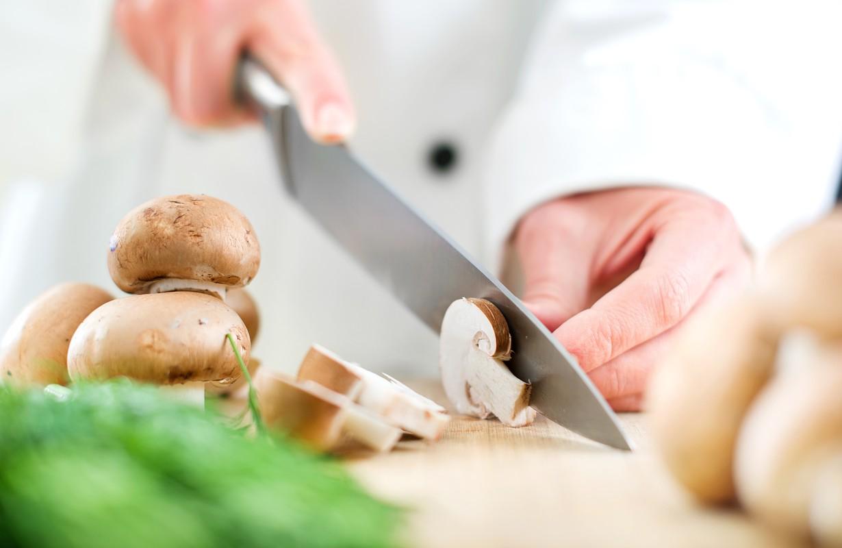 Chef chopping mushrooms