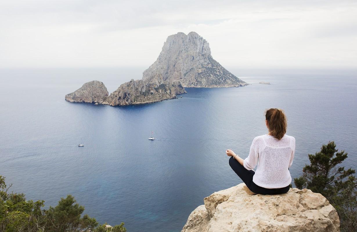 The woman meditates on the island