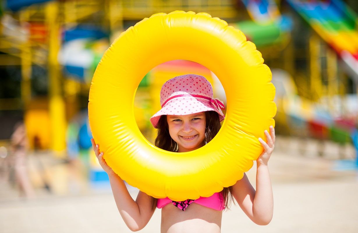 Little beautiful girl goes to the aqua park