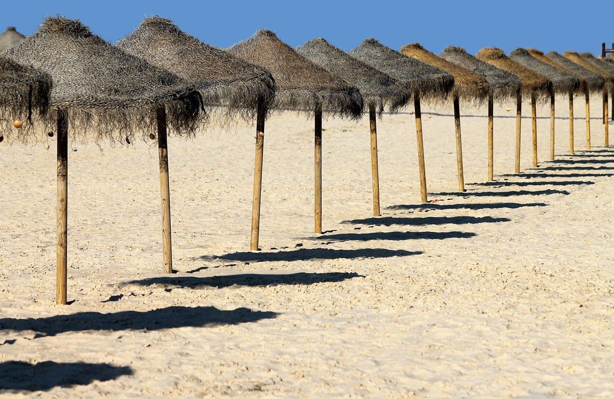 Algarve, Faro - Ilha Deserta beach, southern most part of continental Portugal, in the beautiful Ria Formosa natural reserve. Shinning sands, not many people, warm turquoise Atlantic waters at sunset.