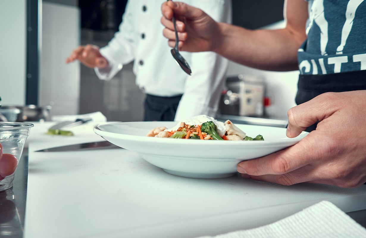 The chef prepares the dish. Try the cooked dish. Cooking. Professional kitchen. Salad dressing. Spices for salad