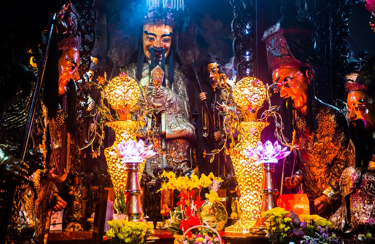Statues with candles at mysterious Jade Emperor Pagoda, Ho Chi Minh City in Vietnam