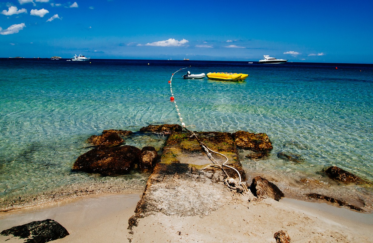 Turquoise sea in the beach of playa d'en bossa with a solitary yellow buoy, Ibiza,Spain