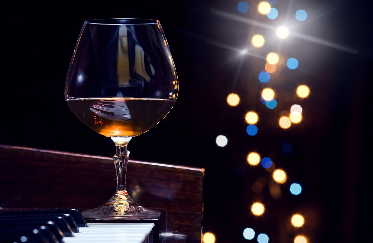 Glass of Brandy on Piano