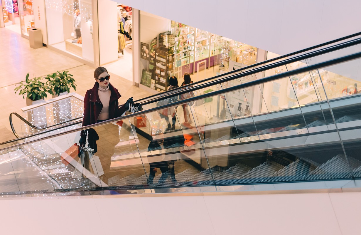 Woman on an escalator at a shopping centre