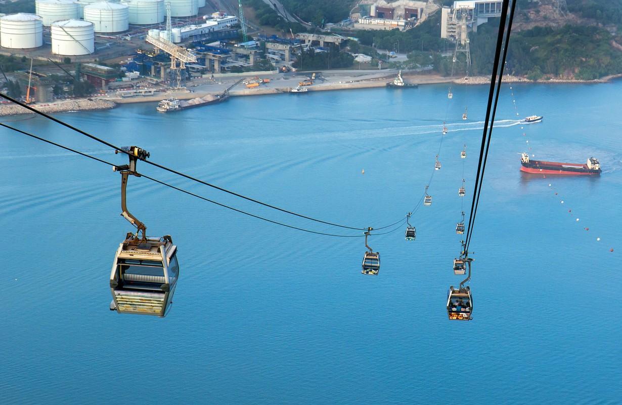 Cabins cable-way ride above sea to the island Lantau, Hong Kong.