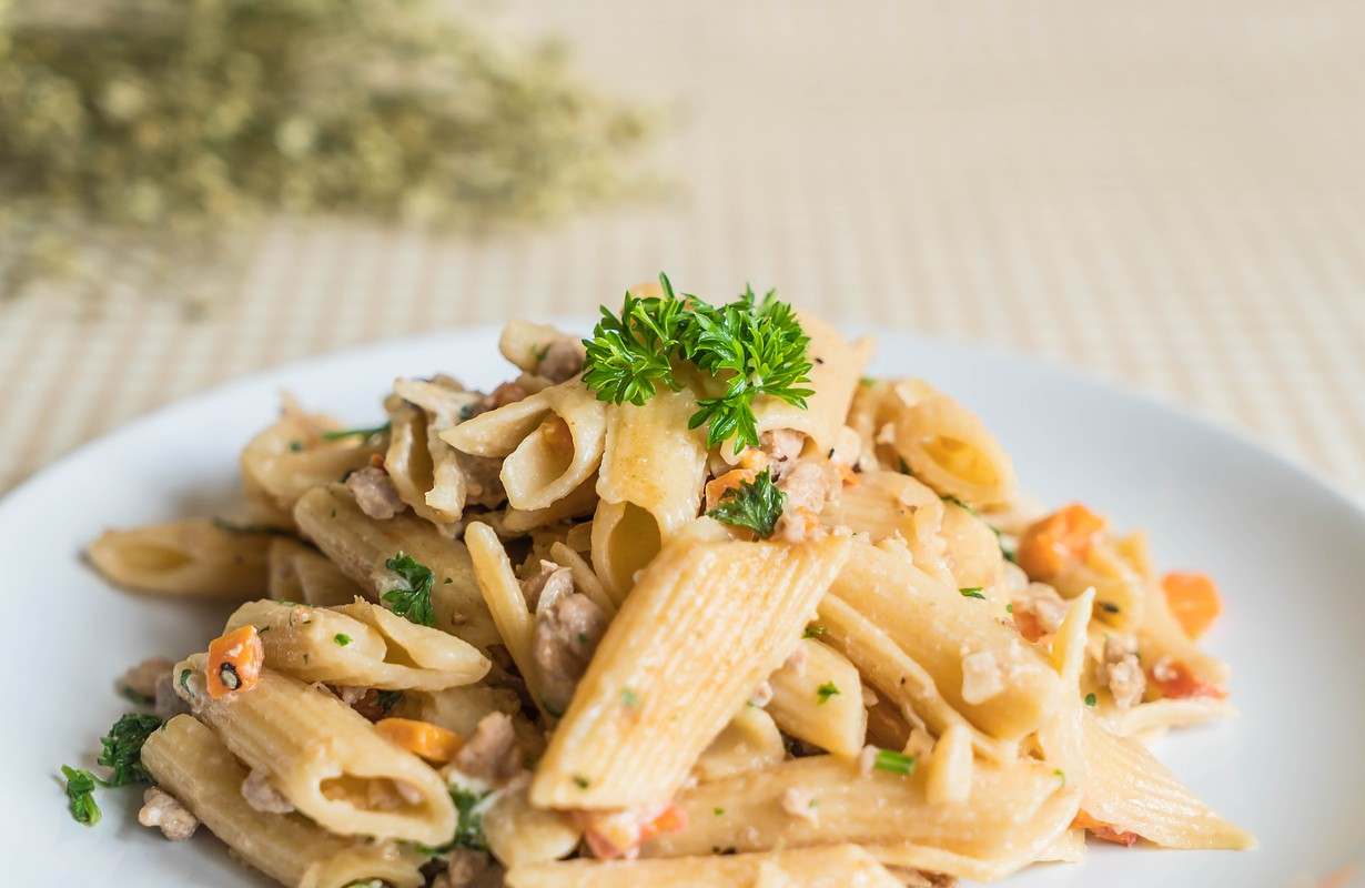 penne pasta cream cheese on table - Image