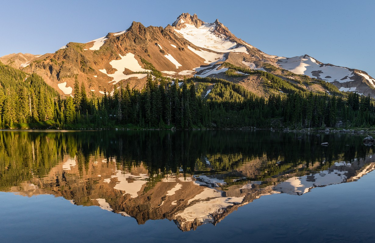 Mt Jefferson is Oregon's second tallest mountain. Reflected here in Scout Lake at sunset
