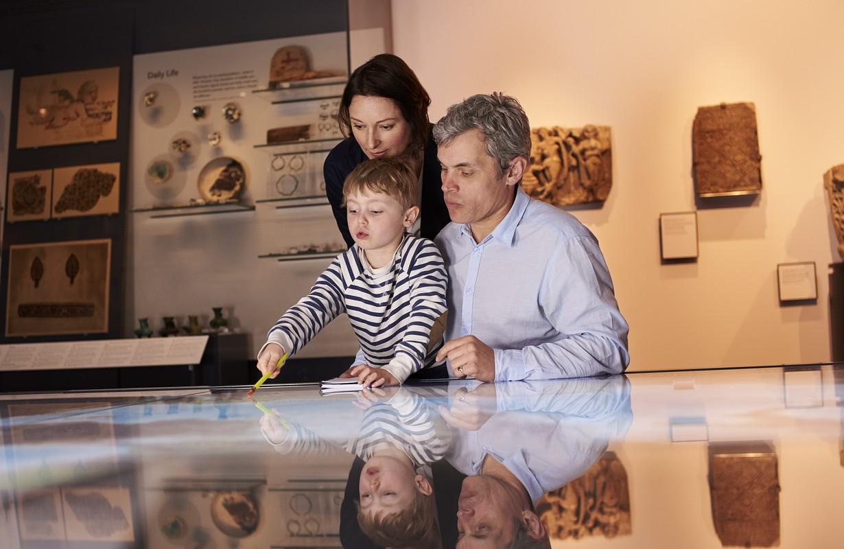Family visiting exhibition at Museum Østjylland (East Jutland Museum) in Randers, Denmark