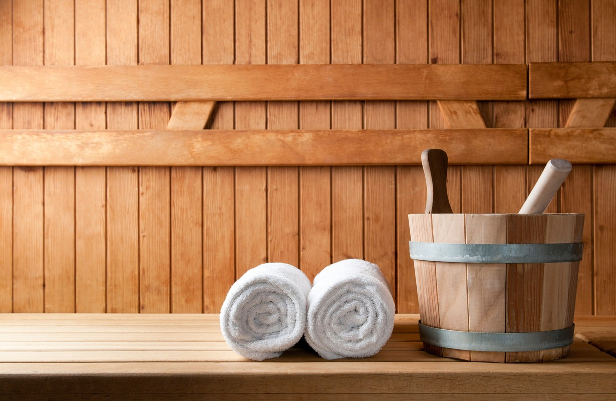 Detail of bucket and white towels in a sauna