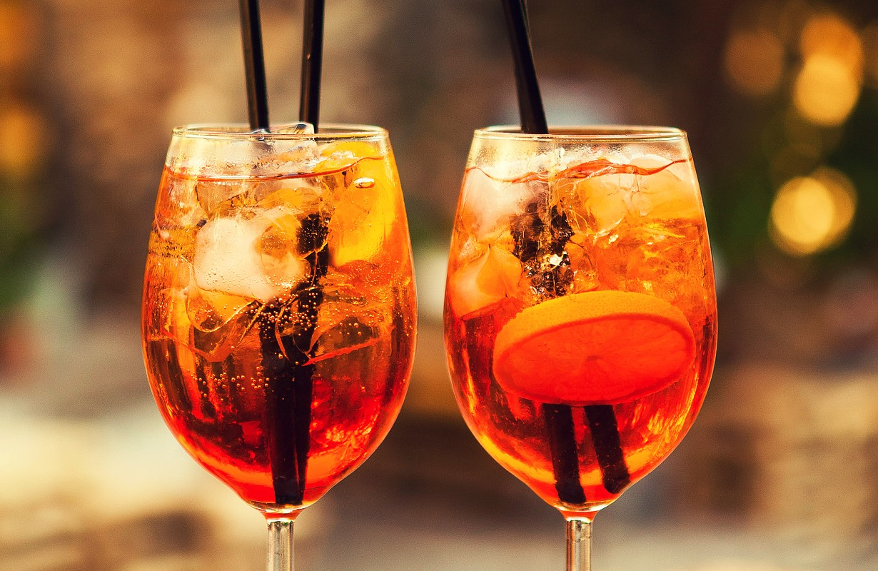 Two glasses of Aperol Spritz cocktails on the table in restaurant