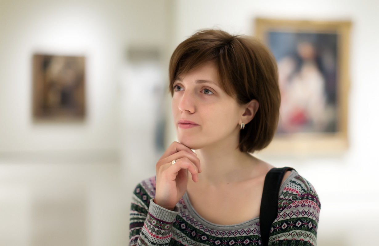 Young woman in art museum