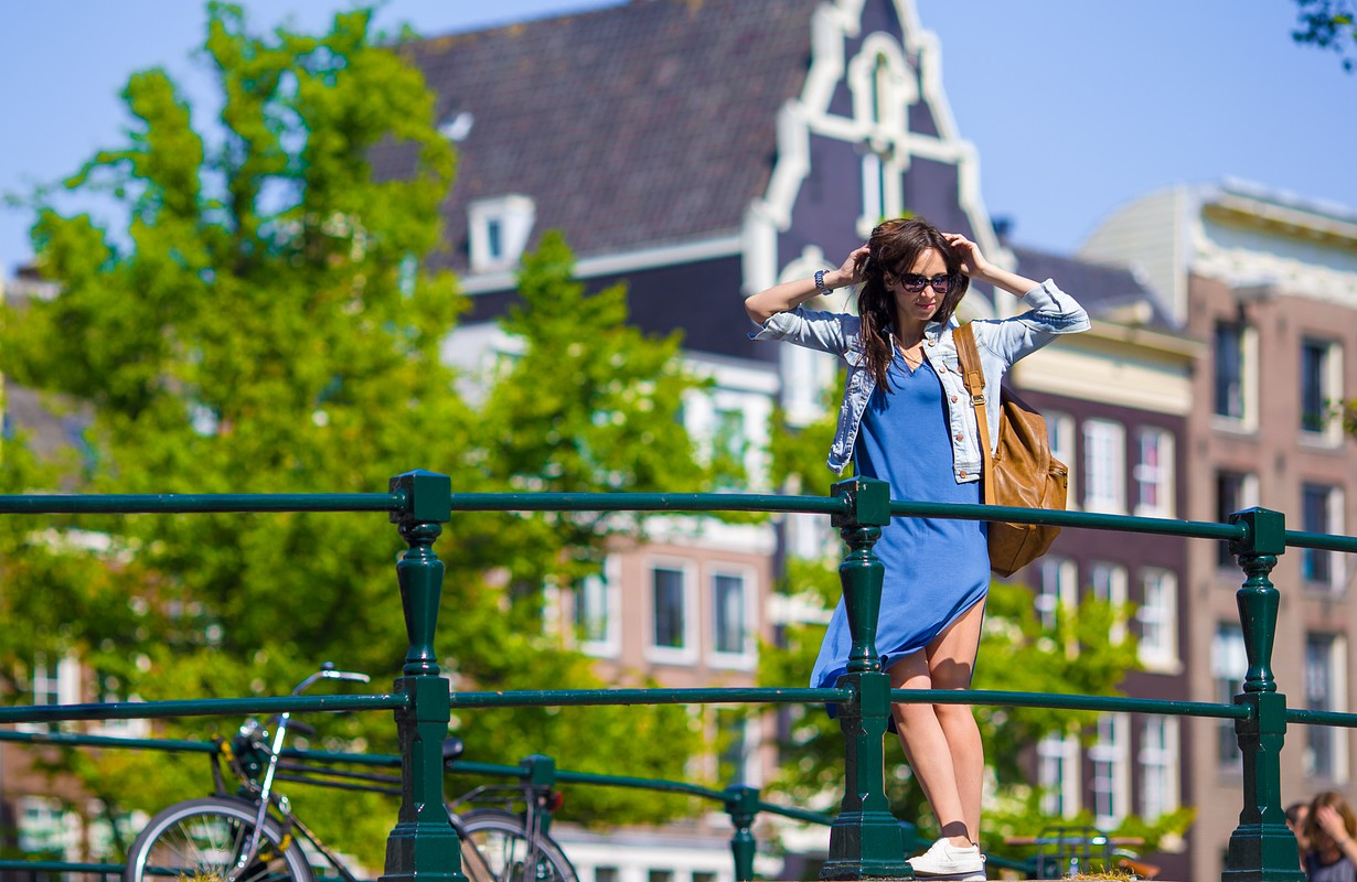 Young woman walking in european city, Amsterdam