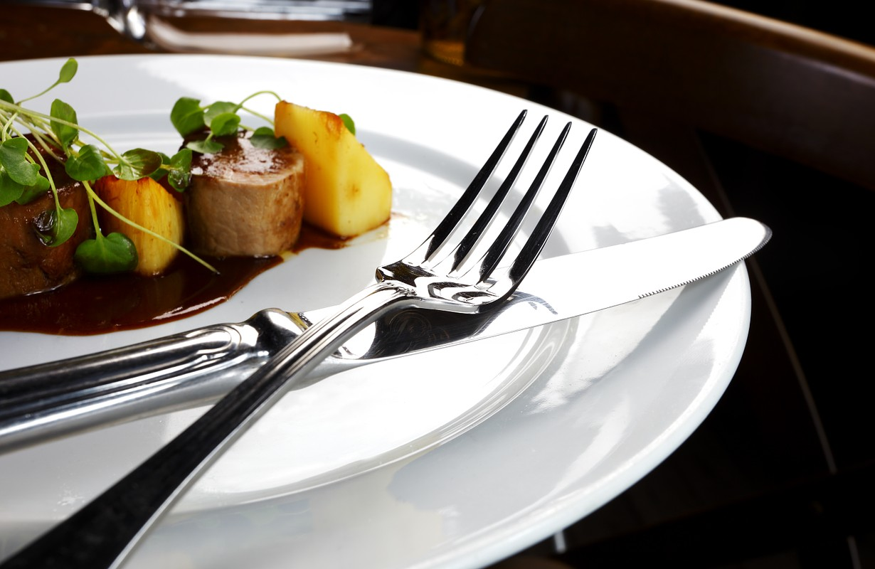 Elegant dish and cutlery on table