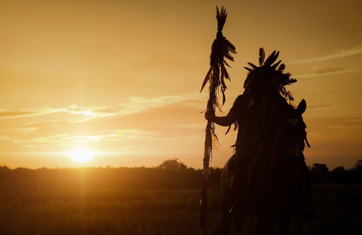 Silhouette Native American man