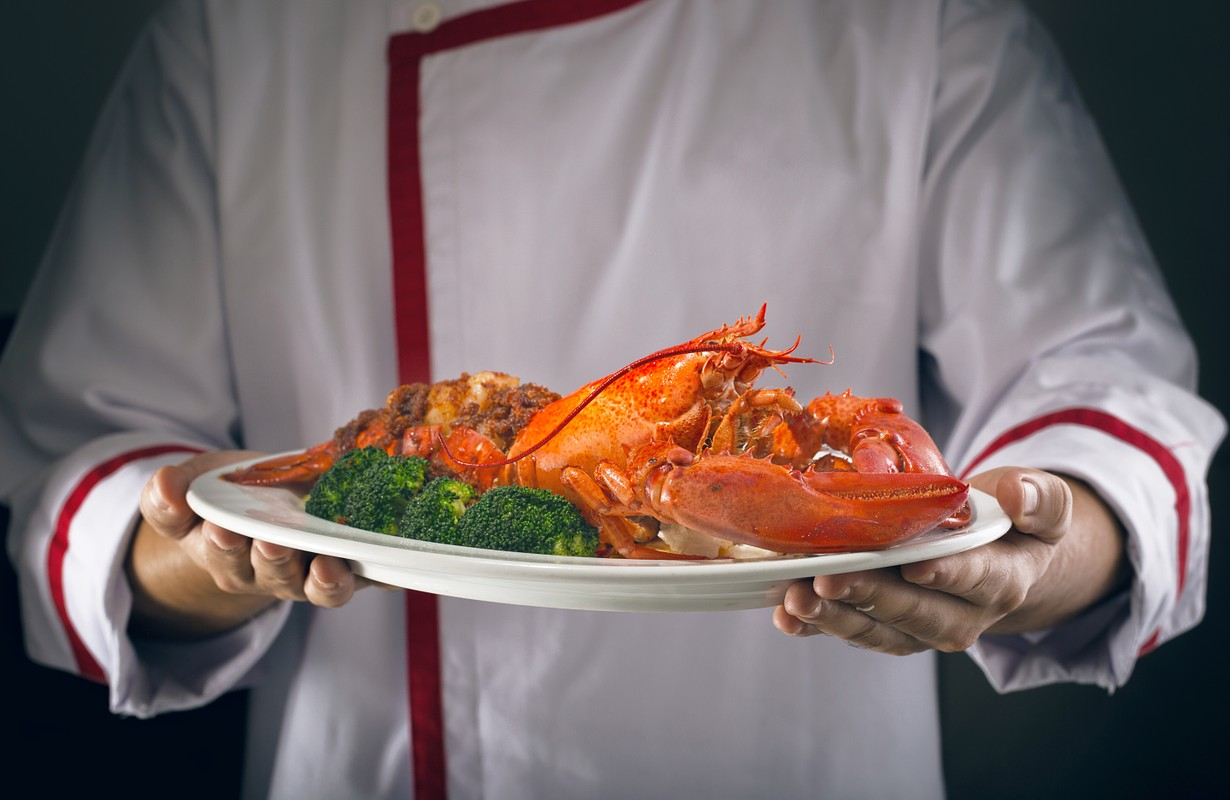 Chef serving a lobster dish - Los Angeles, California