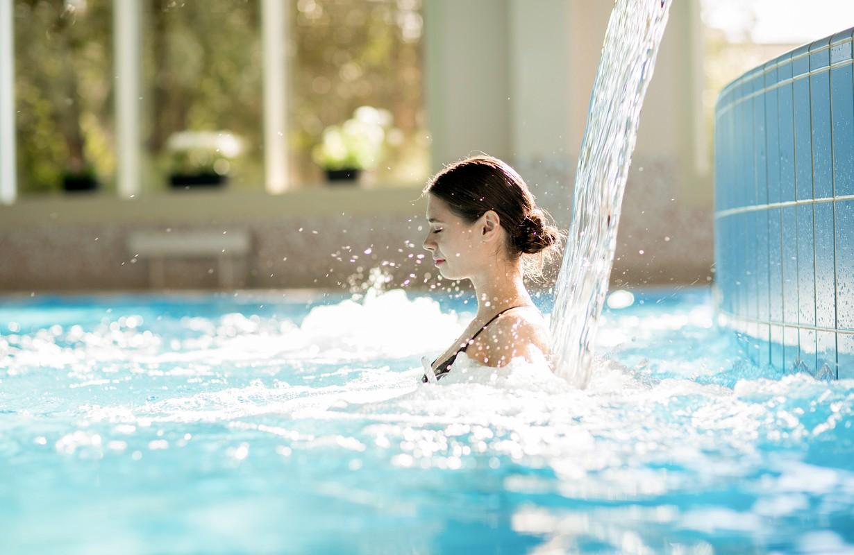 girl enjoying spa in pool