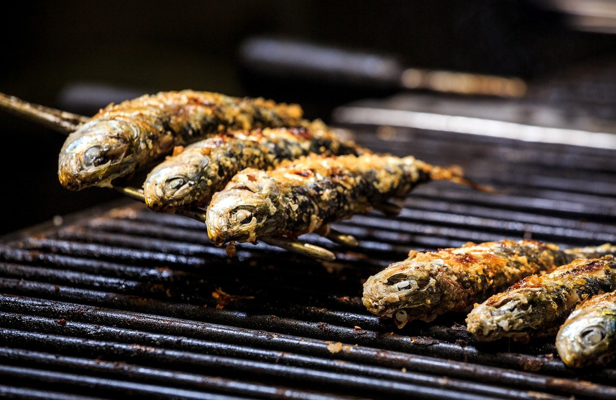 Freshly grilled sardines on the grill