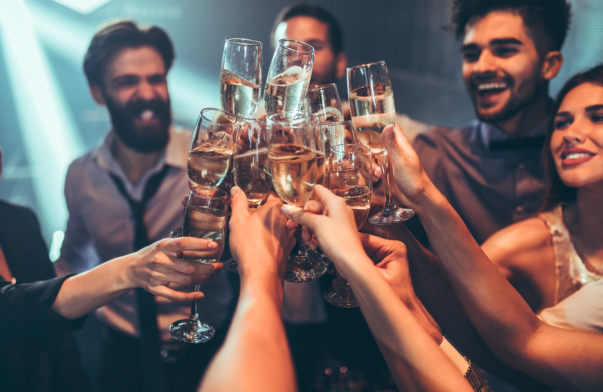 Group of friends toasting with champagne - Houston, Texas