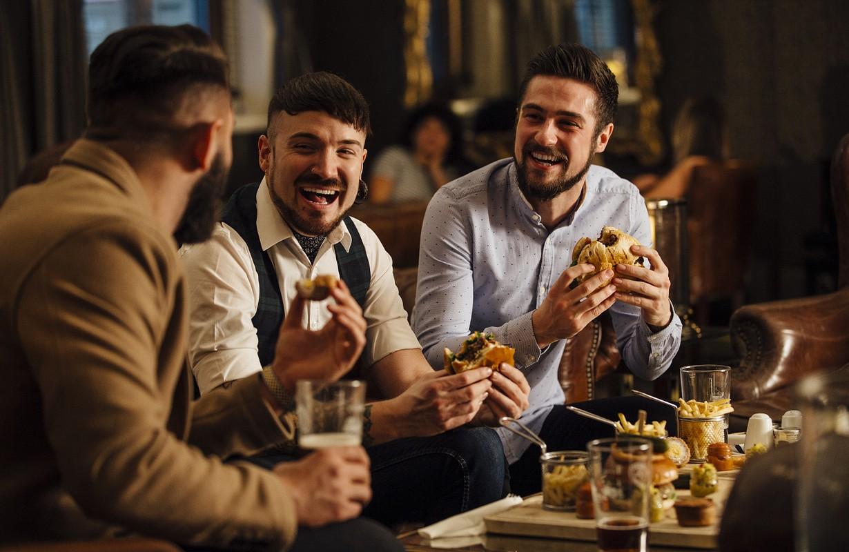 Three men eating burgers - Atlanta, Georgia