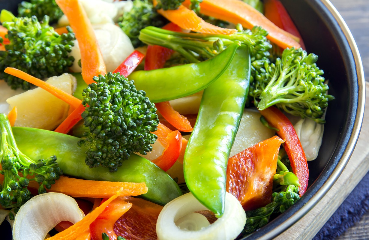 Healthy stir fried vegetables in the pan and ingredients close up, vegetarian food