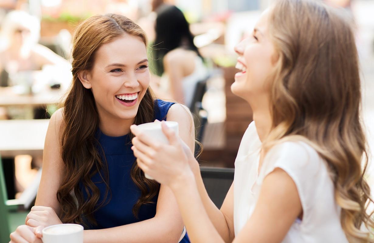 Girls drinking coffee outside