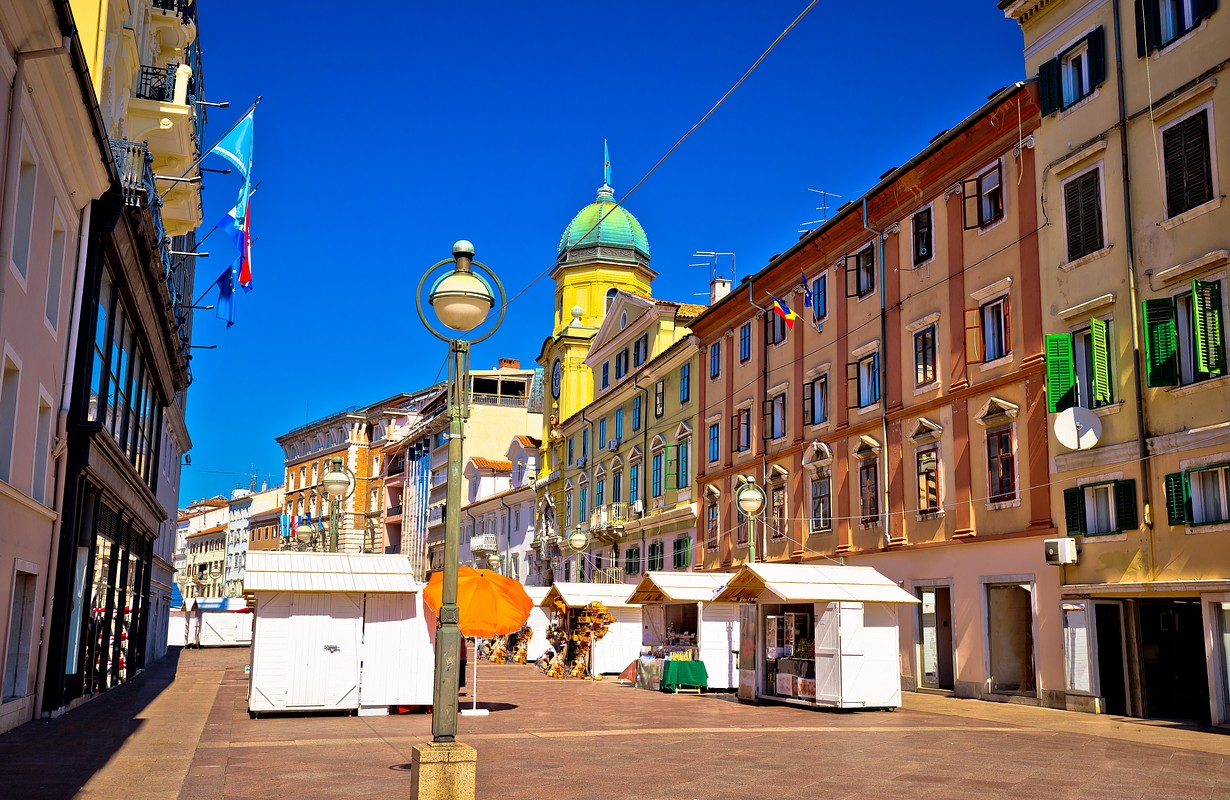 Korzo square in city of Rijeka, clock tower and colorful architecture, Kvarner bay, Croatia