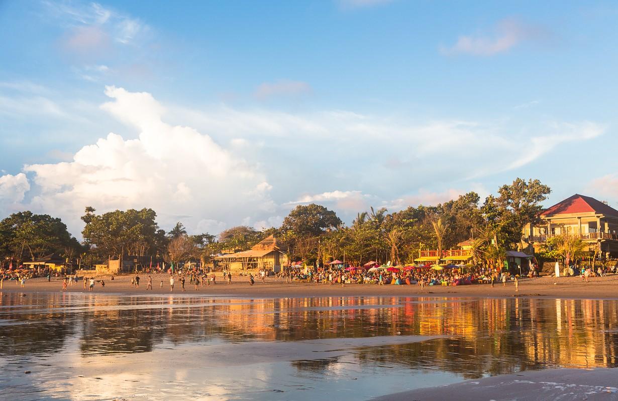 Kuta beach in Seminyak in south Bali at sunset, Indonesia