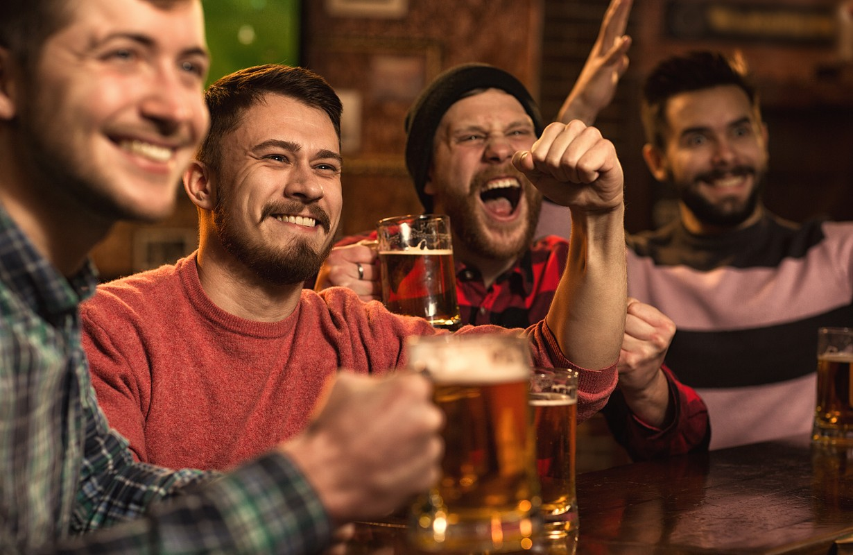 Men watching a football match at a sports bar - San Francisco, California