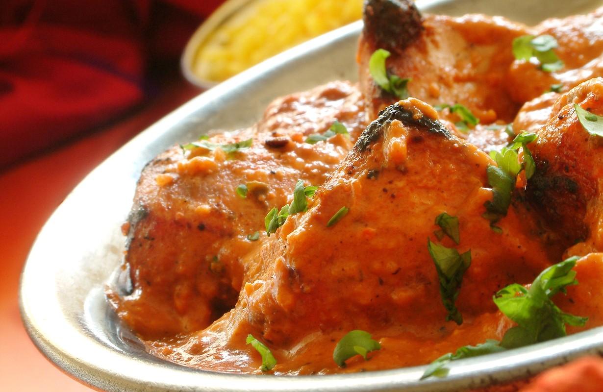 chicken tikka in dish with pilau rice