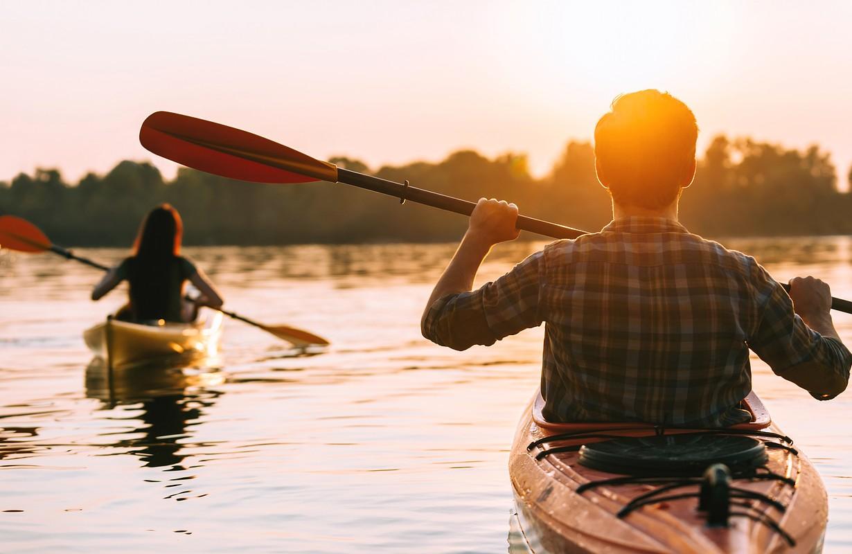 Meeting sunset on kayaks