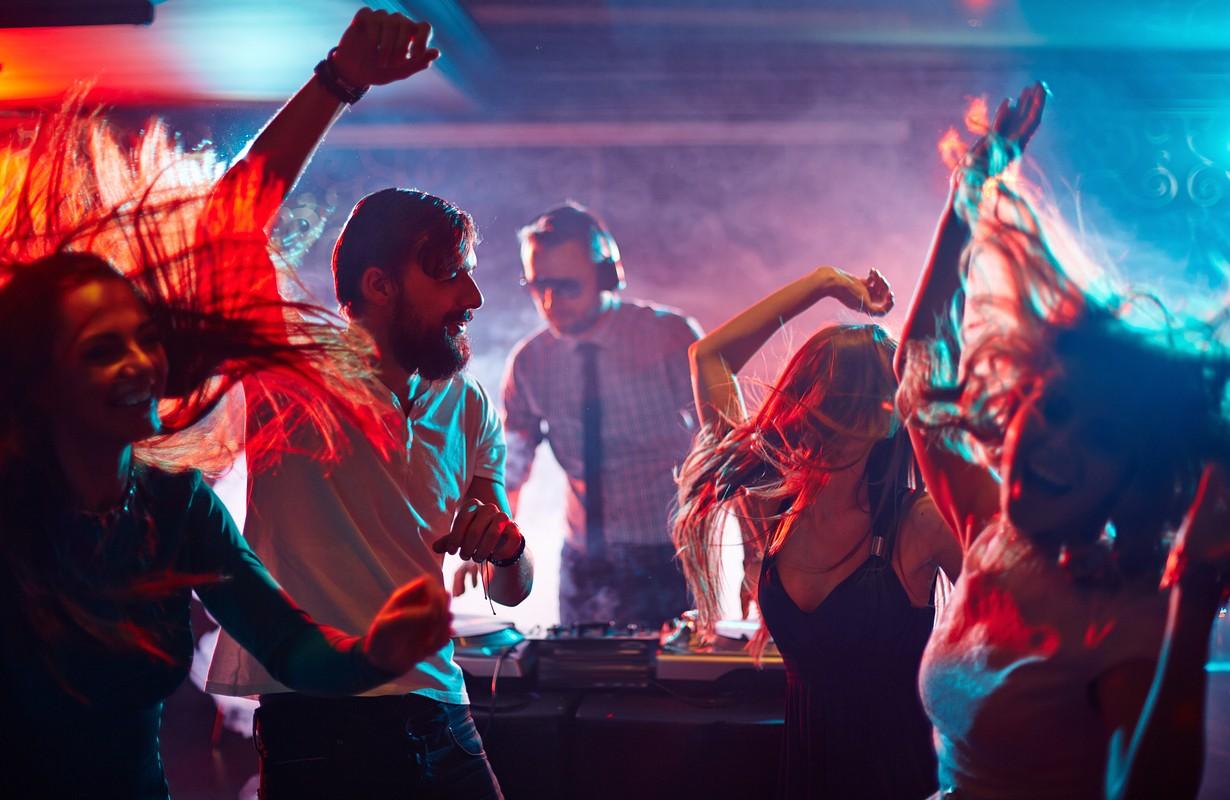 People and DJ dancing at Tante Olga in Randes, Denmark