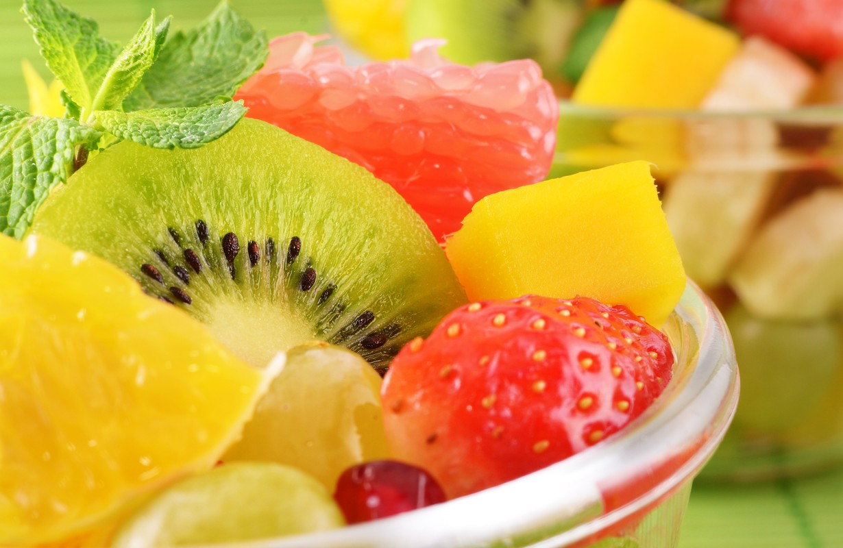 Healthy fruit salad in the glass bowl