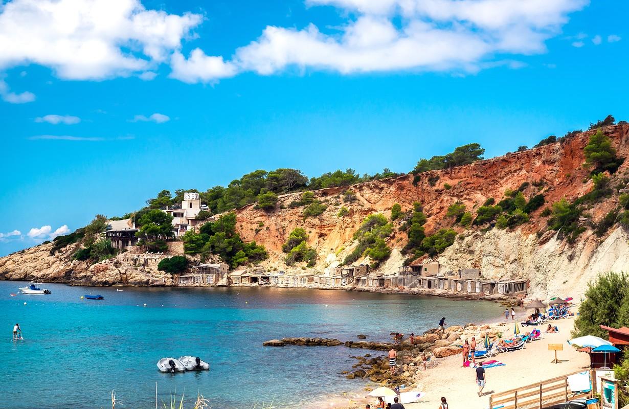People relaxing on the Cala d'Hort beach. Ibiza, Balearic Islands. Spain