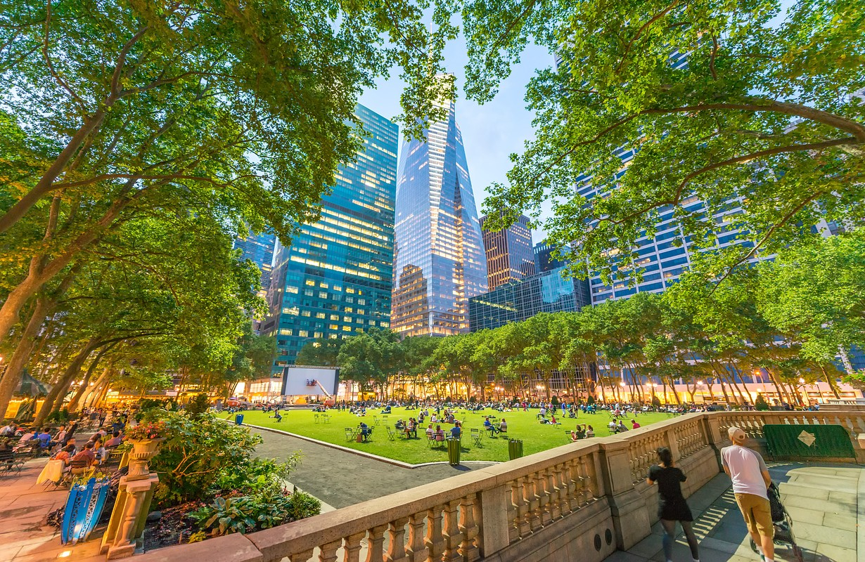 Relaxing in Bryant park after dusk. Manhattan, New York City.