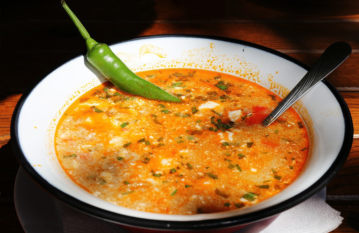 Beef soup with sour cream and hot chili
