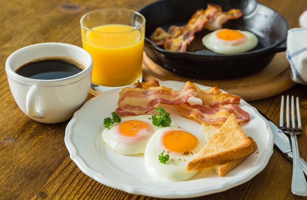 American breakfast with eggs, bacon, toast, coffee and juice - Houston, Texas