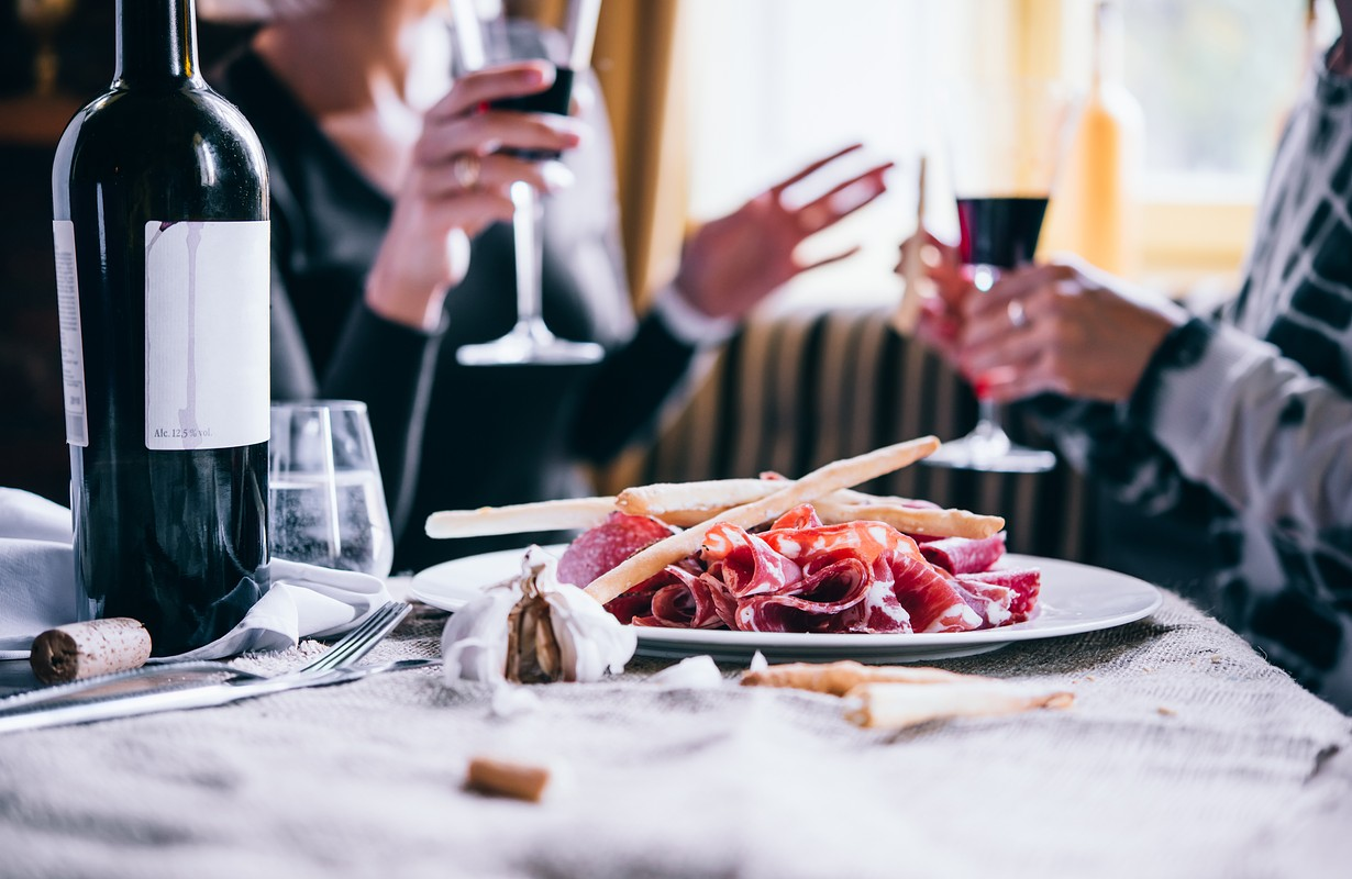 Customers having appetizers and wine at an Italian restaurant