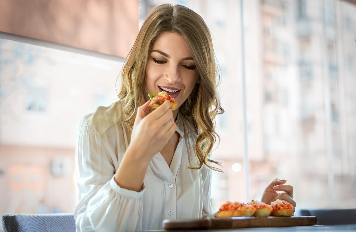 elegant woman eating in cafe