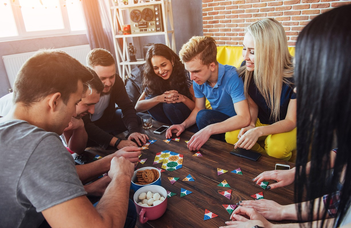 Group of friends playing board games in a café