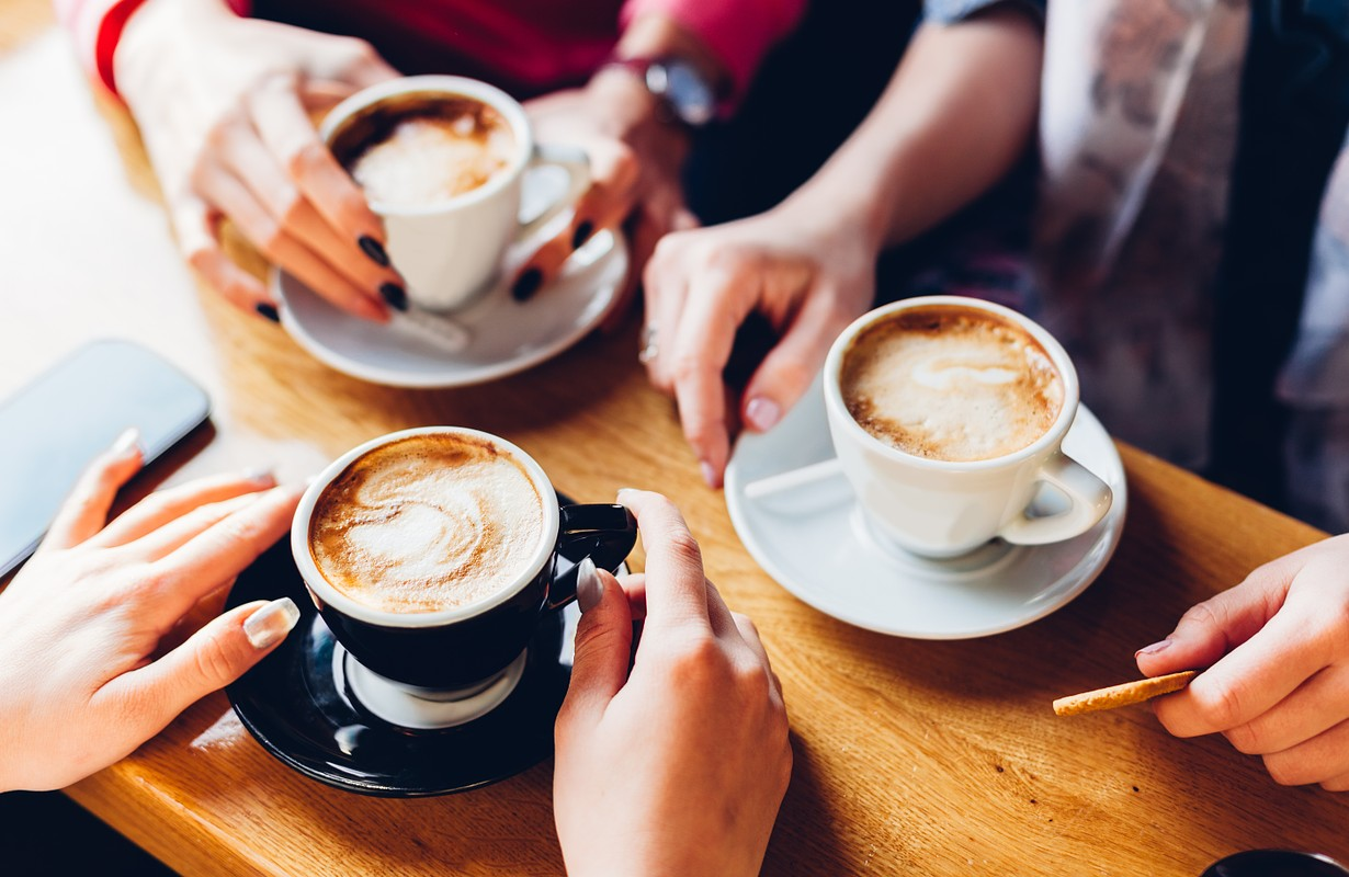 Friends with coffee at Café Mathisen in Randers, Denmark