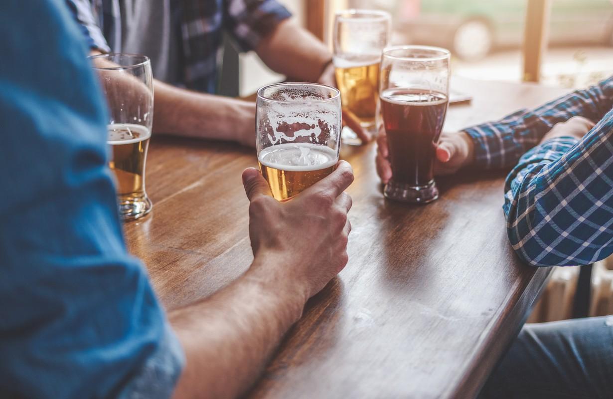 Men holding glasses of beer