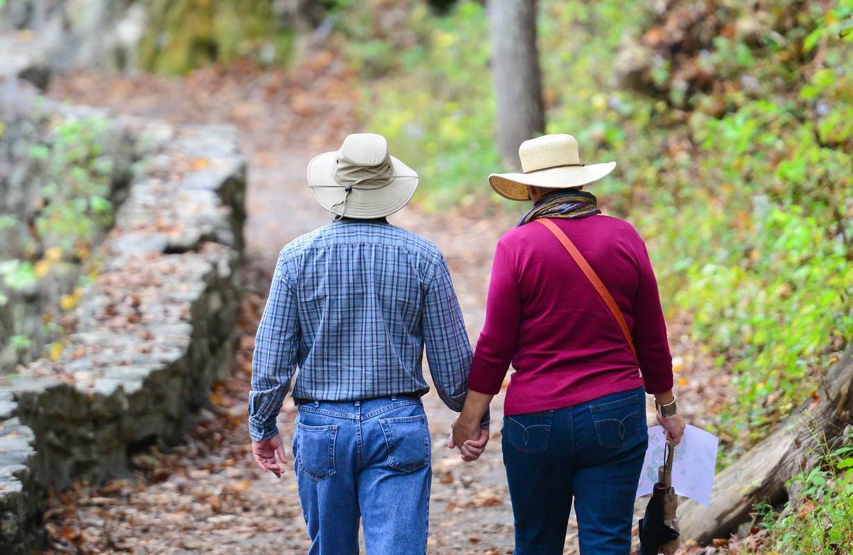 Senior couple hiking in Autumn forest