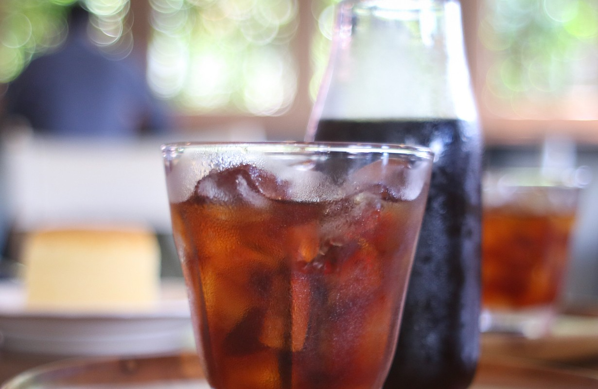 Selective focus of close up of cold brewed black coffee in summer with ice in a glass