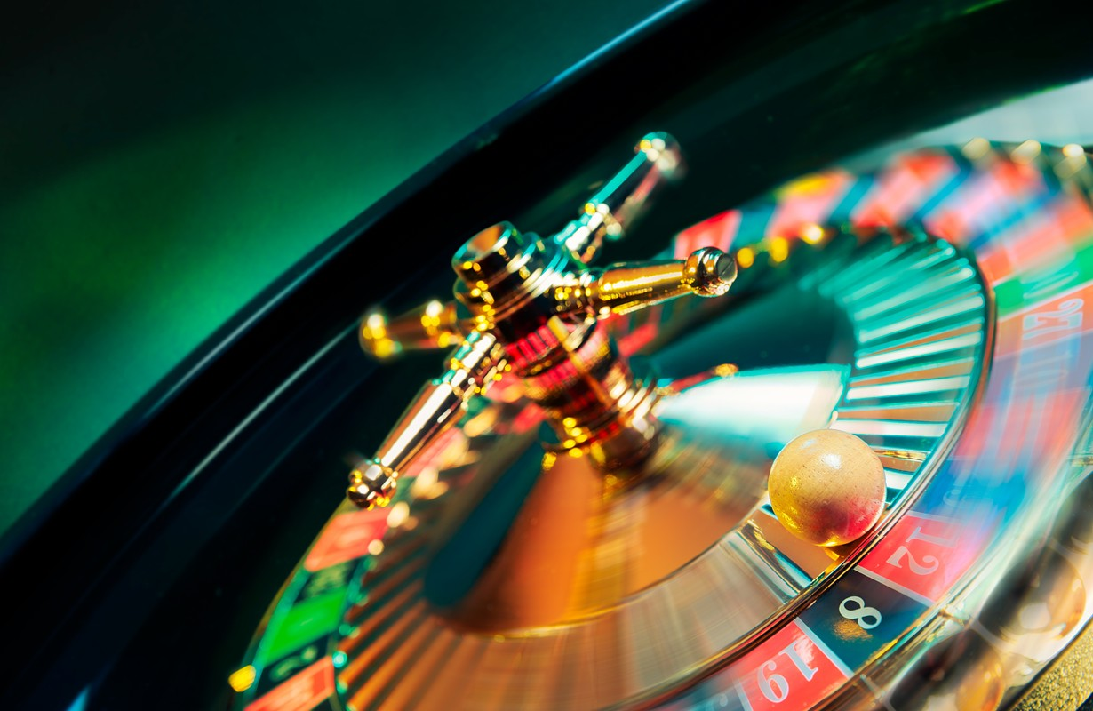 high contrast image of casino roulette in motion / selective focus on ball