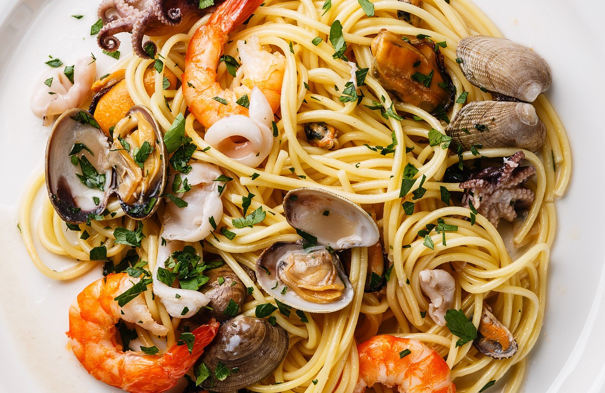 Seafood pasta Spaghetti with Clams, Prawns, Seafood Cocktail close up - Image