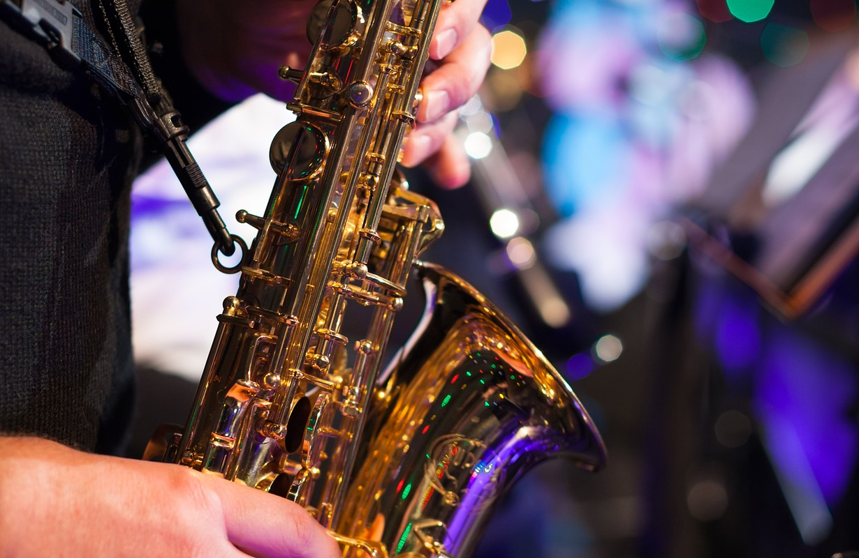 Photo of the male jazz saxophonist playing in sax