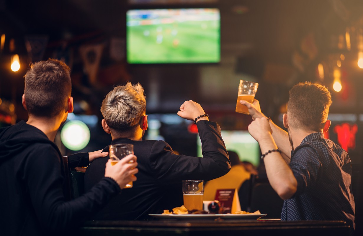 Men watching a football game in a bar